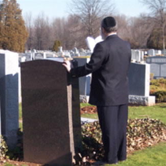 Man at Graveside Service - Link